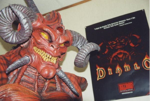 Diablo costume and poster